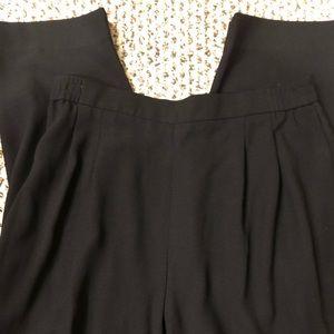 Black dress pants. Pleated front, back closure